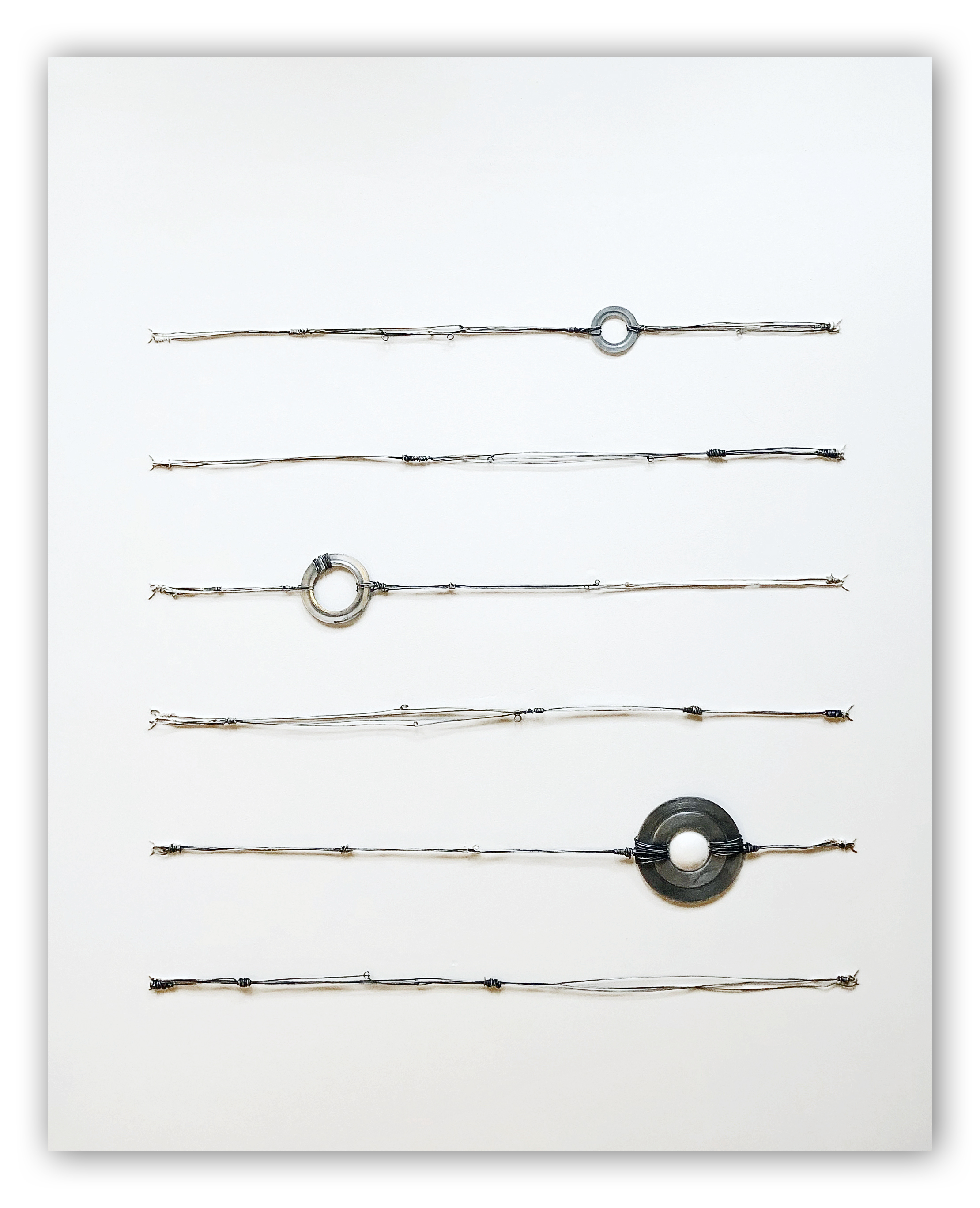 """""""Saturn"""", 2020, mixed media with wire, hardware, sculpted spheres and aqua resin on wood panel"""
